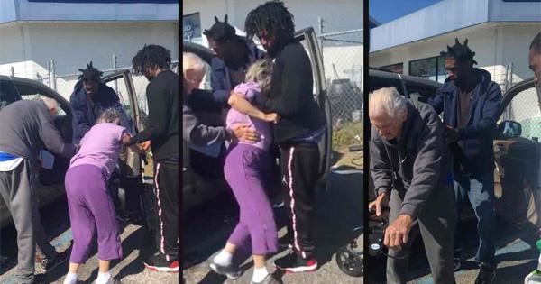 Three young Black men helping elderly couple
