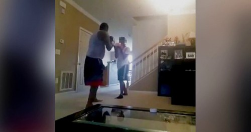 Tavis Sellers boxing with teen son