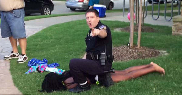 White Officer Pinned Down Teen Black Girl