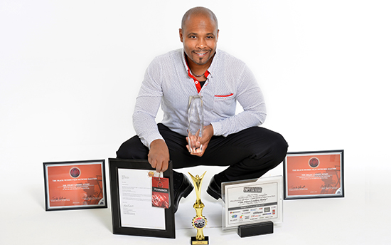 Mike Ray with his awards