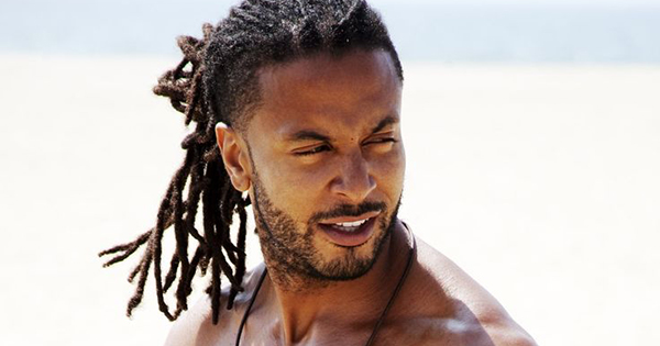 Black man with dreadlocks