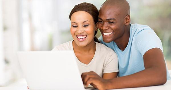 Black couple using laptop