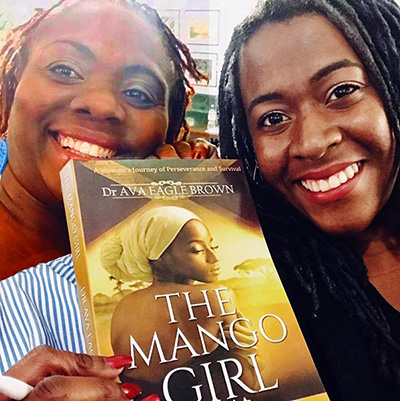 Dr. Ava Eagle Brown during a book signing with a fan