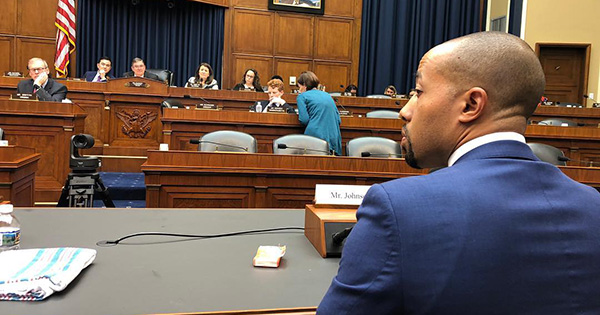 Charles Johnson IV sitting before Congress