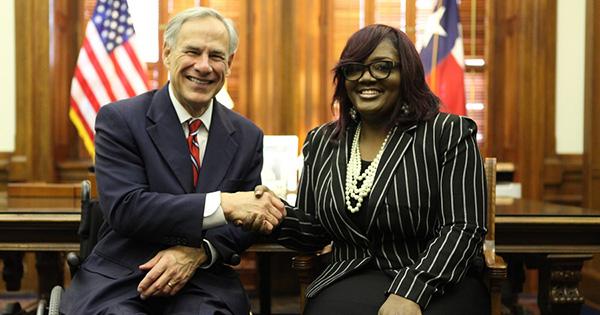 Tamala Austin, founder of J.I.V.E. Juice with the governor of Texas