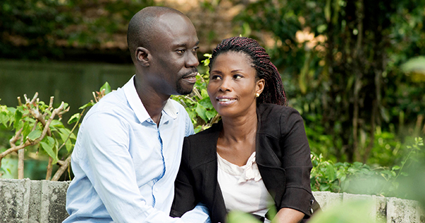 Black married couple sitting in a park