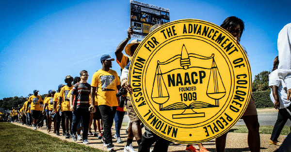 NAACP members marching