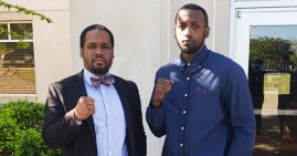 Former NFL player Desmond Marrow with his attorney