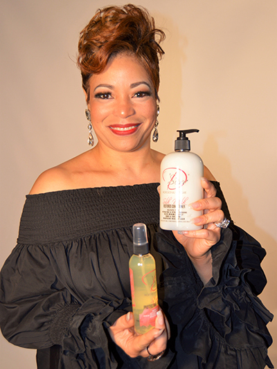Angela Brown, founder of D'Serv hair care products
