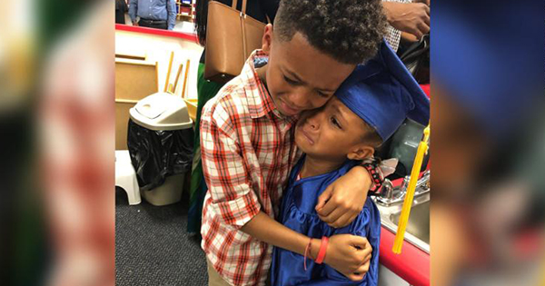 Derek and Charlee Smith hug during Kindergarten graduation