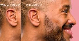 Black man wearing Vanish hearing aid
