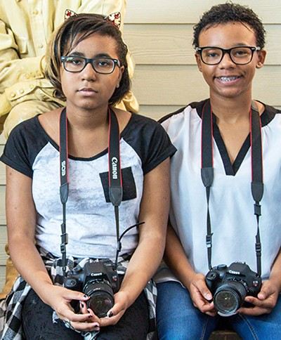 Teens learning photography at B-Roll Media and Arts in Maryland