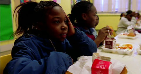 African American students eating school lunch