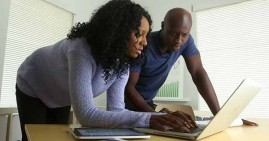 Black man and woman entrepreneurs working together